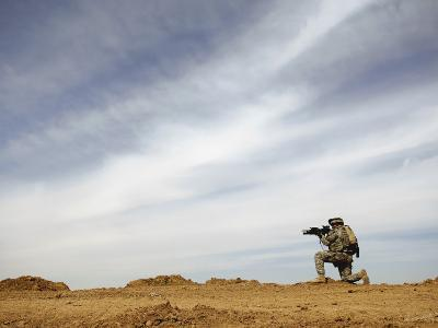 US Army Sergeant Provides Security During a Patrol of the Riyahd Village in Iraq
