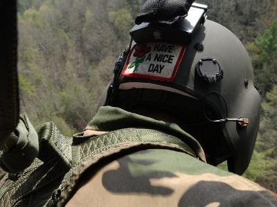 US Army National Guardsman Looks out a UH-60 Black Hawk Helicopter During a Search and Rescue