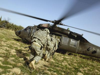 US Army Soldiers Prepare to Board a UH-60 Black Hawk Helicopter