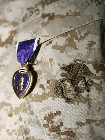 A Soldier Wears His Purple Heart on His Digital Camouflage Minutes after Being Awarded the Medal