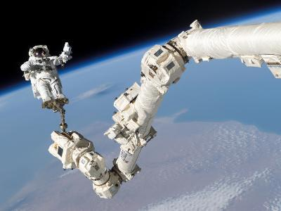 Astronaut Anchored to a Foot Restraint on the International Space Station's Canadarm2