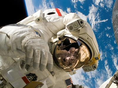 An Astronaut Mission Specialist Participates in the Mission's Extravehicular Activity
