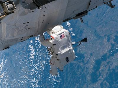Mission Specialist Traverses the Station Hardware During Installation Day on the Space Station