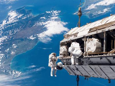 STS-116 Mission Specialists Participate in the First of the Three Mission's Extravehicular Activity