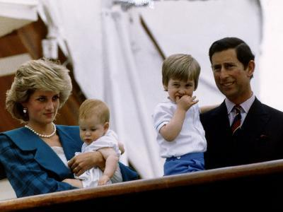 Prince Charles stands holding sons Prince William and Prince Harry with Princess Diana, Circa 1985