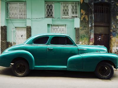 Classic 1950's Car Parked Outside House in Chinatown District