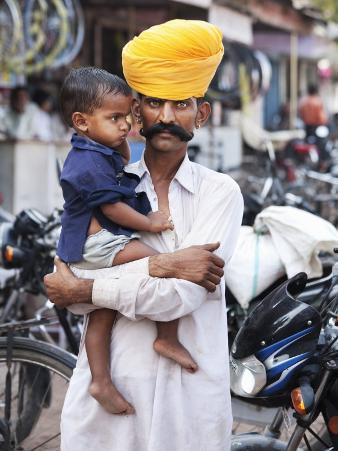 Rajasthani Man and His Son Waiting for Chai Near Local Motorcycle Shop