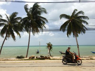Motorcyclist Driving by Northern Coast of Ko Samui