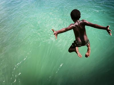 Torres Strait Islander Boy Leaping into the Sea, Seisia, Cape York