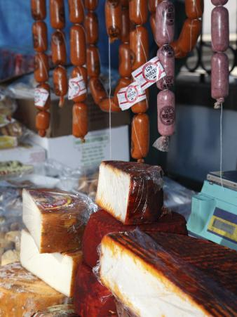 Hanging Sausages and Goat's Cheese on Farmers' Market Stall Near Plaza Nuestra Senora Del Pino