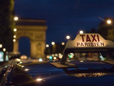 Taxi on Champs Elysees at Dusk