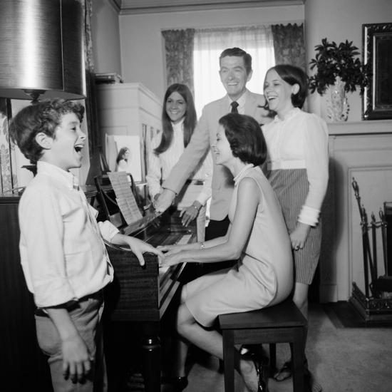 Image result for family around the piano