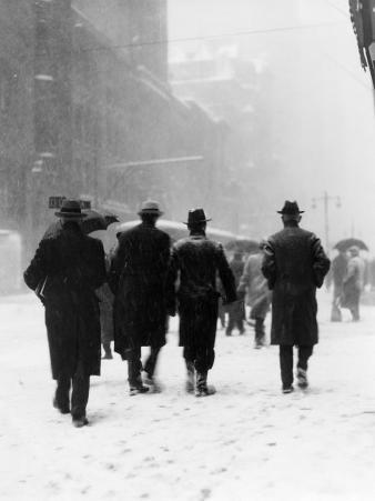 Pedestrians in Winter Snow, Walking Away From the Camera, Wearing Hats and Boots