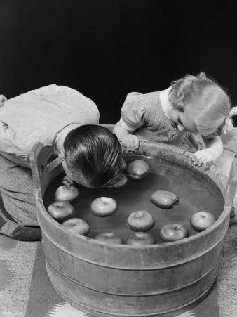 Little Boy and Girl Bobbing For Apples Fall Halloween Party Indoor