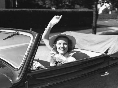 Elegant Woman in Convertible Car, Waving, Portrait