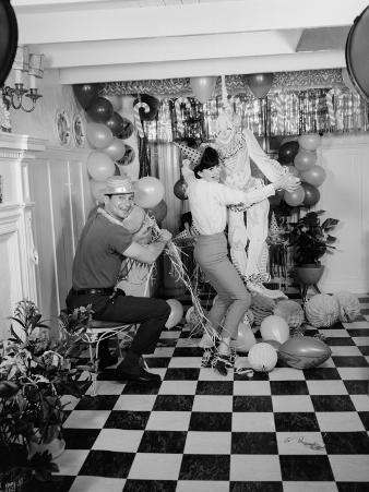 Portrait of Couple Preparing Decoration For House Party