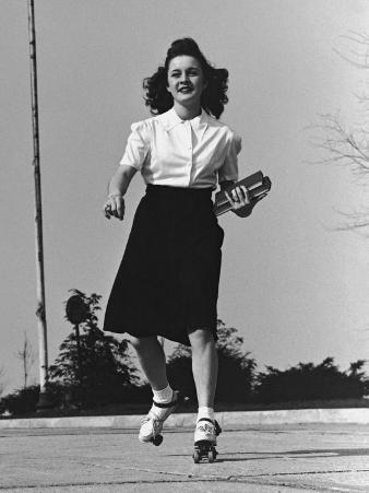 Teenage Girl Roller Skating To College, Carrying Books, 1950's