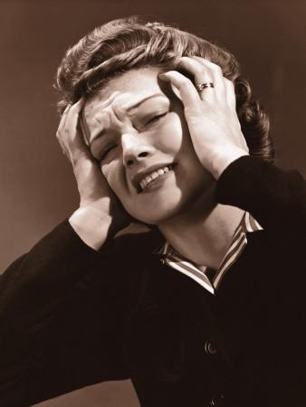 Woman Clutching Her Head in Pain, With Both Hands
