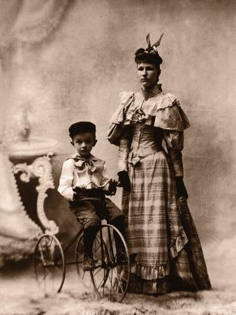 Boy (4-6) on Tricycle With Mother