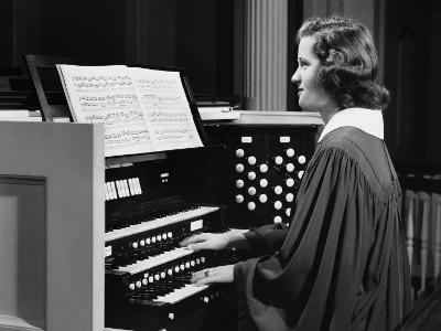Woman Playing Organ in Church