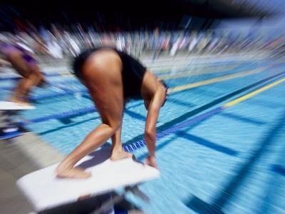 Female Swimmer at the Start of a Race