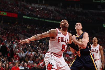 Indiana Pacers v Chicago Bulls - Game Two, Chicago, IL- April 18: Carlos Boozer and Tyler Hansbroug