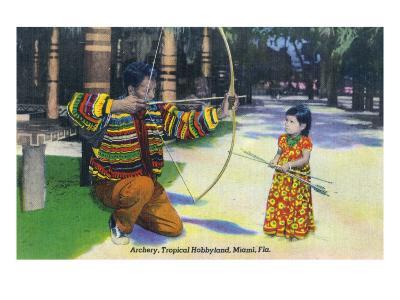 Miami, Florida - Tropical Hobbyland; Seminole Dad Showing Daughter Archery