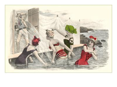 Man Snapping Picture of Bathing Beauties