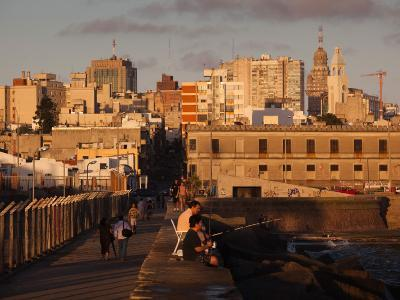 People on a Pier, Escollera Sarandi, Montevideo, Uruguay