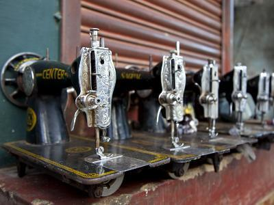India, Mysore; Recently-Repaired Sewing Machines Outside a Sewing-Machine Repair Shop in Mysore