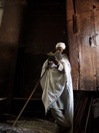 Ethiopia, Lalibela; a Priest in One of the Ancient Rock-Hewn Churches of Lalibela