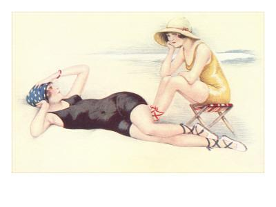 Women in Bathing Costumes Lounging on Beach