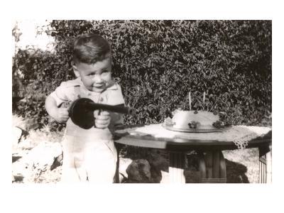Little Boy with Toy Machine Gun and Cake