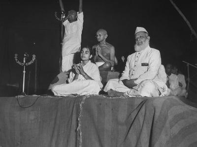 Hindu Leader Mohandas Gandhi with Others Participating in Twilight Prayer