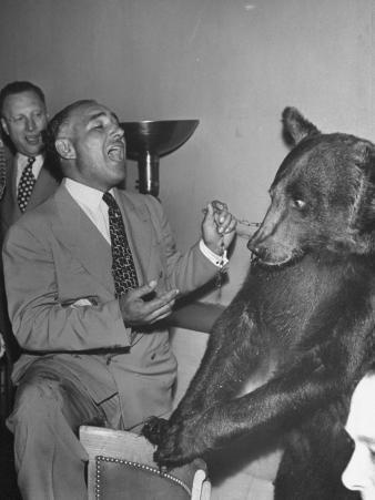 Man Singing to Trained Bear Named Rosie