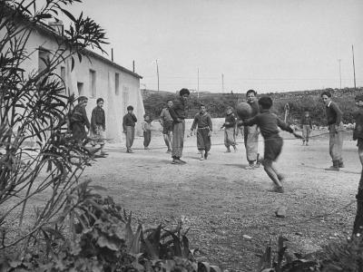 Residents of Italian Boystown Playing Soccer