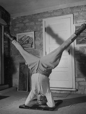 Folk Singer John Jacob Niles Performing Elbow-Standing Exercise, Adapted from Yoga, to Relax