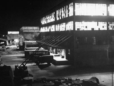 Exterior of Firestone Tire and Rubber Co. Plant at Night