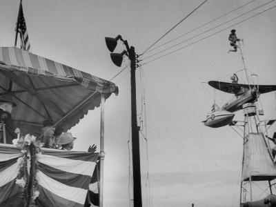 President Harry S. Truman Watching an Aerial Act at a Carnival