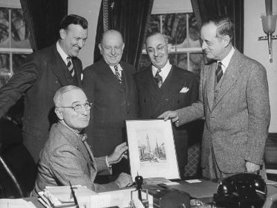 President Harry S. Truman Amd Others Looking at a Picture in the Oval Office