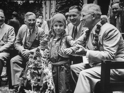 President Harry S. Truman Receiving Garland from Child