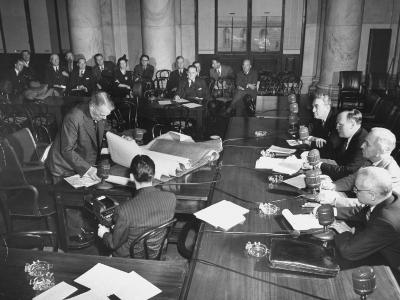 Senator Harry S. Truman and Others Listening to Man Testifying before a US Senate Committee