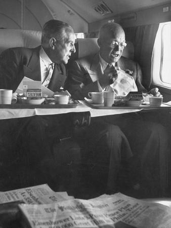 Dwight D. Eisenhower Seated in Airplane Eating Breakfast and Talking to Paul G. Hoffman
