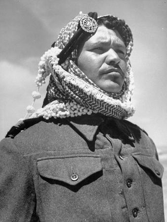 A Soldier from the Arab Legion Squinting His Eyes to Keep Out the Sun