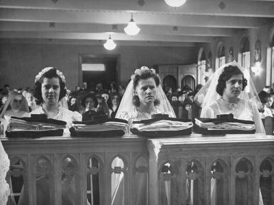 Nuns of the Carmelite Order Taking their Novice Vows in their Bridal Dresses
