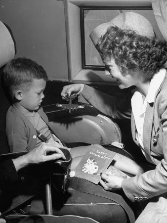 "Stewardess Tempting Little Boy with Model Airplane Aboard the United Airlines ""Nurseryliner"""