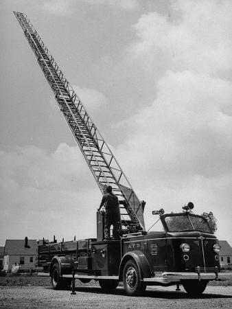 Modern Fire Engine, with Men Raising Ladder Above Truck