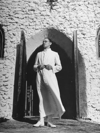 A Man Standing in His Doorway on Whale Cay