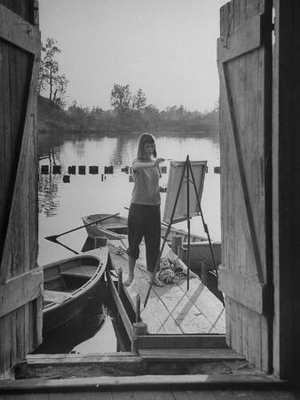 Young Woman Standing on Dock and Painting at Saugatuck Summer Art School