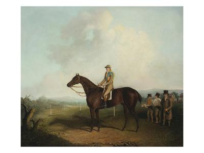Racehorse with Jockey Up, with Trainer, Grooms, and a Grandstand Beyond